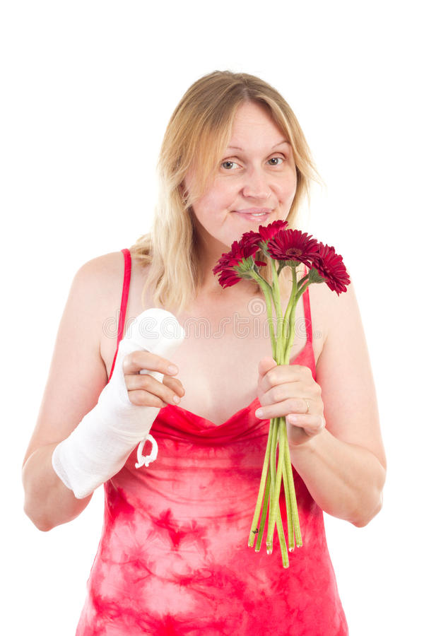Download Woman With Bandaged Hand Sniffs At Flowers Stock Image - Image: 32867839