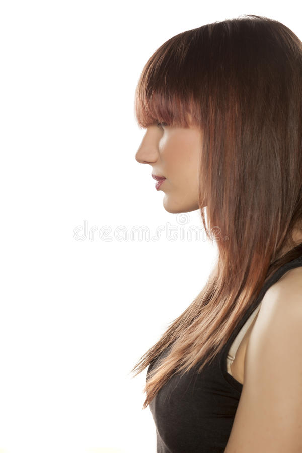 Woman with bangs. Profile of a young woman with bangs royalty free stock photography