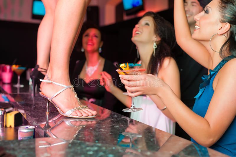 Woman in bar or club is dancing on the table royalty free stock images