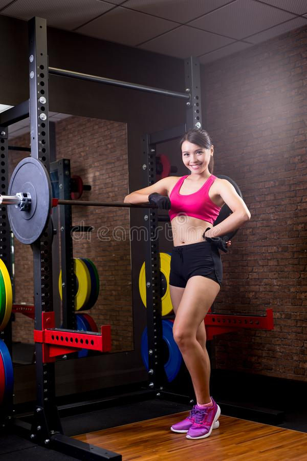 Woman with barbell stock photo