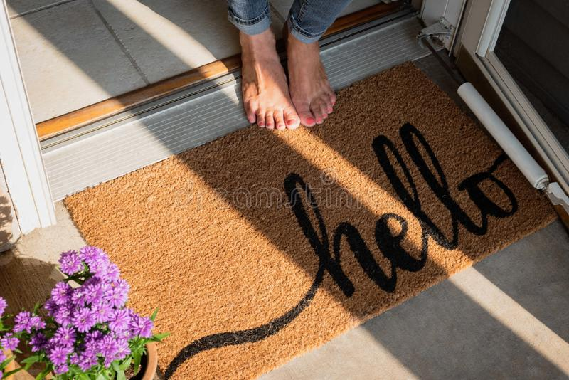 Welcome mat in front of new home royalty free stock photography
