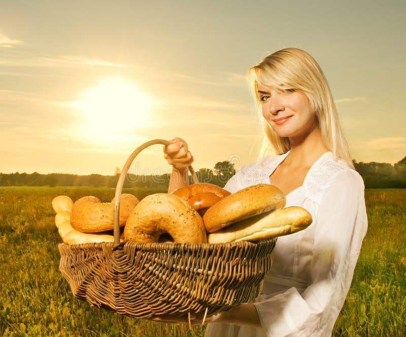 Woman with a basket stock photos