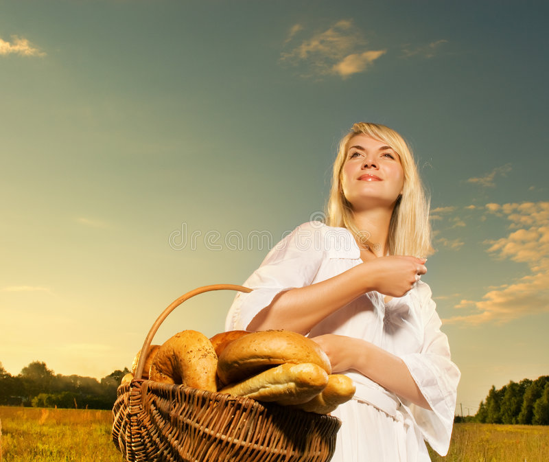 Woman with a basket royalty free stock photography