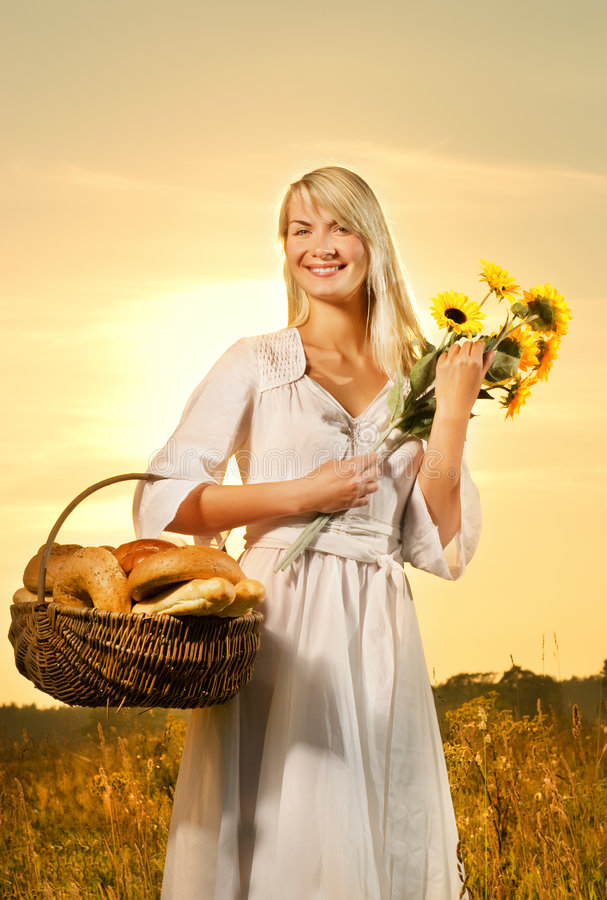 Woman with a basket stock photo