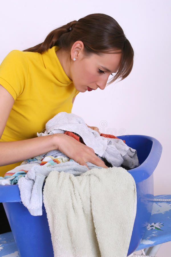 Woman And Basket With Dirty Clothing Royalty Free Stock Photography