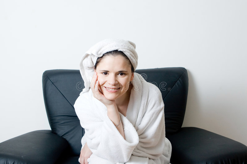 Woman after bath smiling stock photography