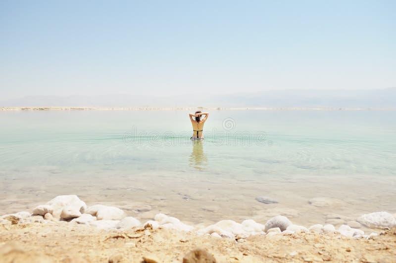 Woman bathe at the Dead Sea stock photo