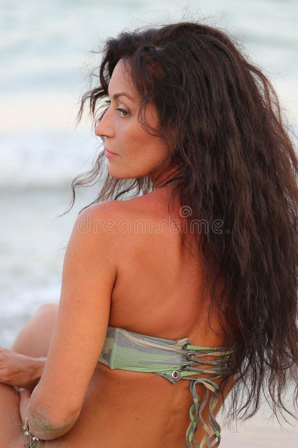 Woman in a bathing suit with tattoos stock photography