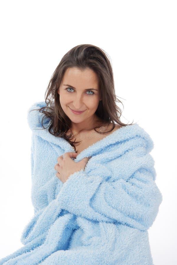 Woman in bathrobe stock photography