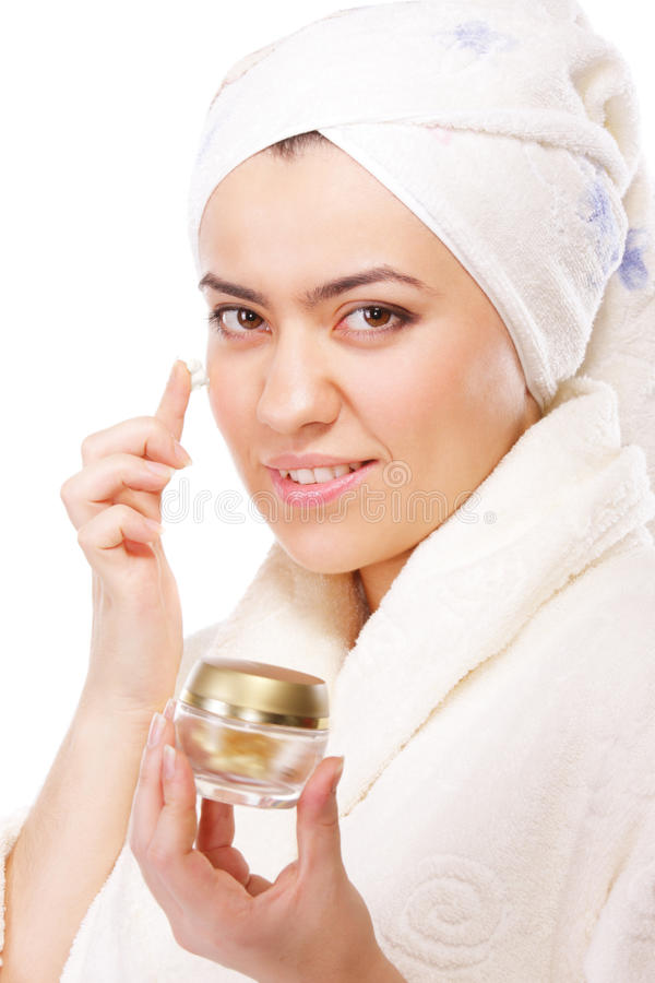 Download Woman In Bathrobe Applying Moisturizer Stock Photo - Image: 12021012