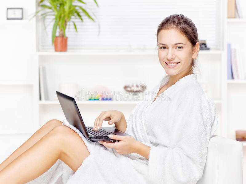 Woman In Bathrobe With Computer Royalty Free Stock Photography
