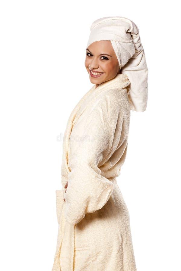 Woman in a bathrobe royalty free stock photo
