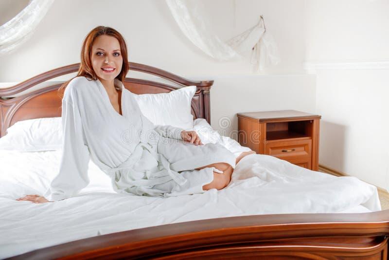 woman in bathrobe waking up stock photos