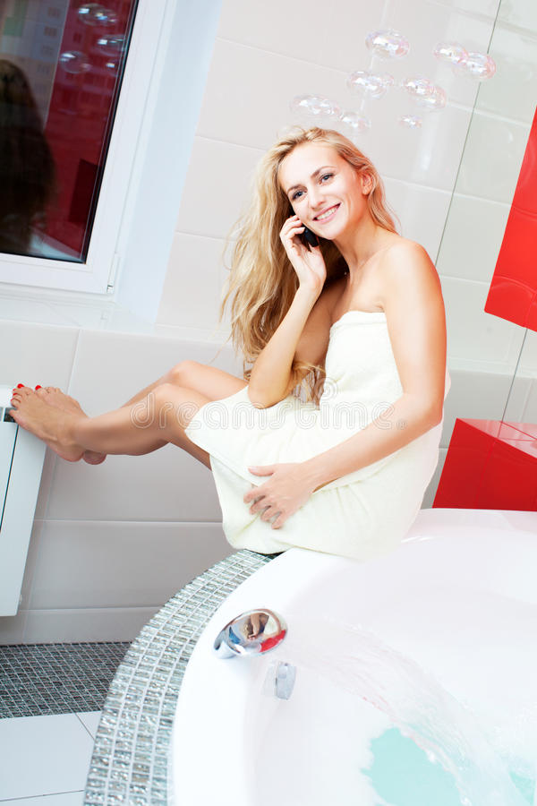 Download Woman In Bathroom Speaking On Phone Stock Photo - Image: 31600744