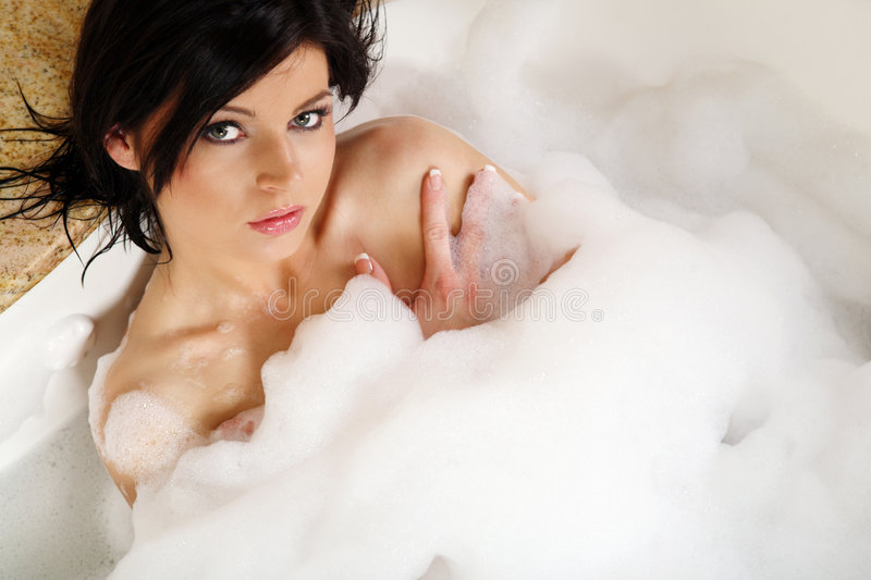 Woman in bathtub. royalty free stock images