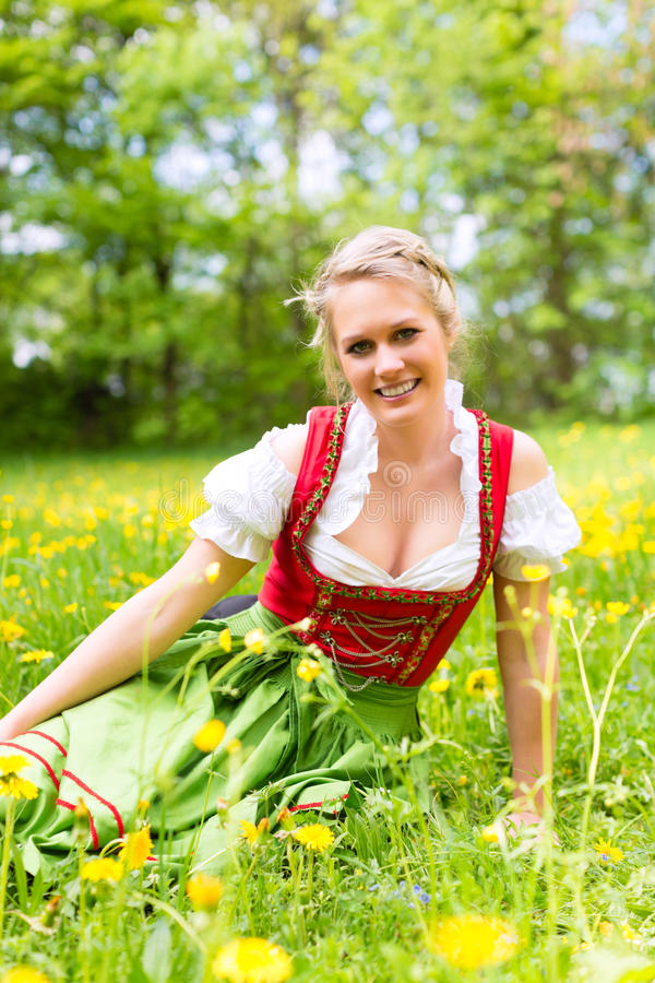 Download Woman In Bavarian Clothes Or Dirndl On A Meadow Stock Photo - Image of flowers, meadow: 26006198