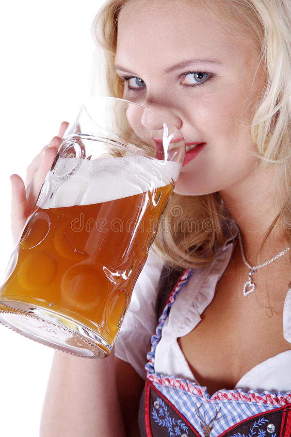 Woman in Bavarian outfit with beer. Beautiful woman in Bavarian outfit with beer royalty free stock photos