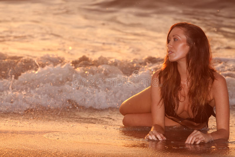 Woman by beach royalty free stock photo