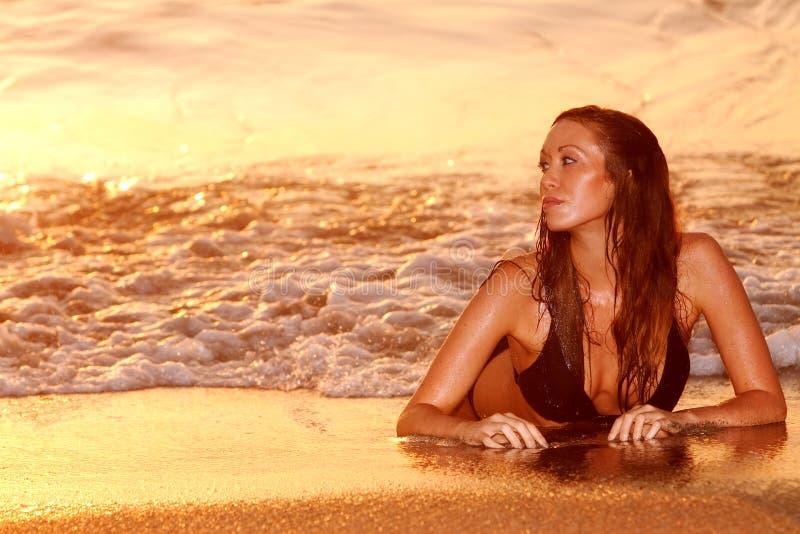 Woman by beach stock photos