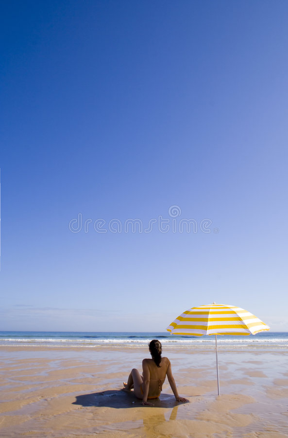 Woman at the beach stock photo