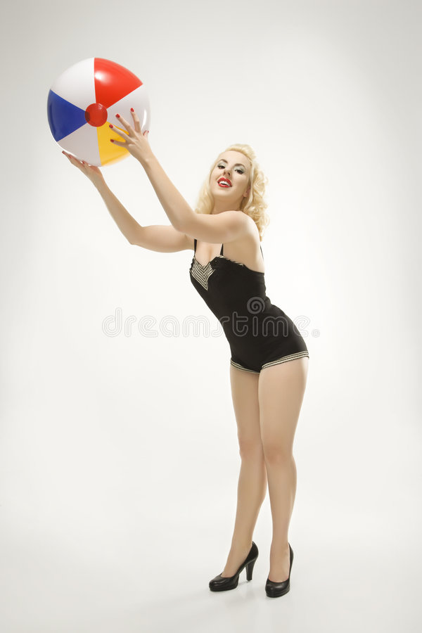 Woman with beach ball.