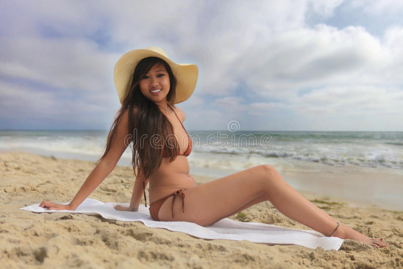 Woman on the Beach in a Bikini Sitting royalty free stock images