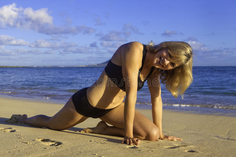Woman at the beach in hawaii royalty free stock images