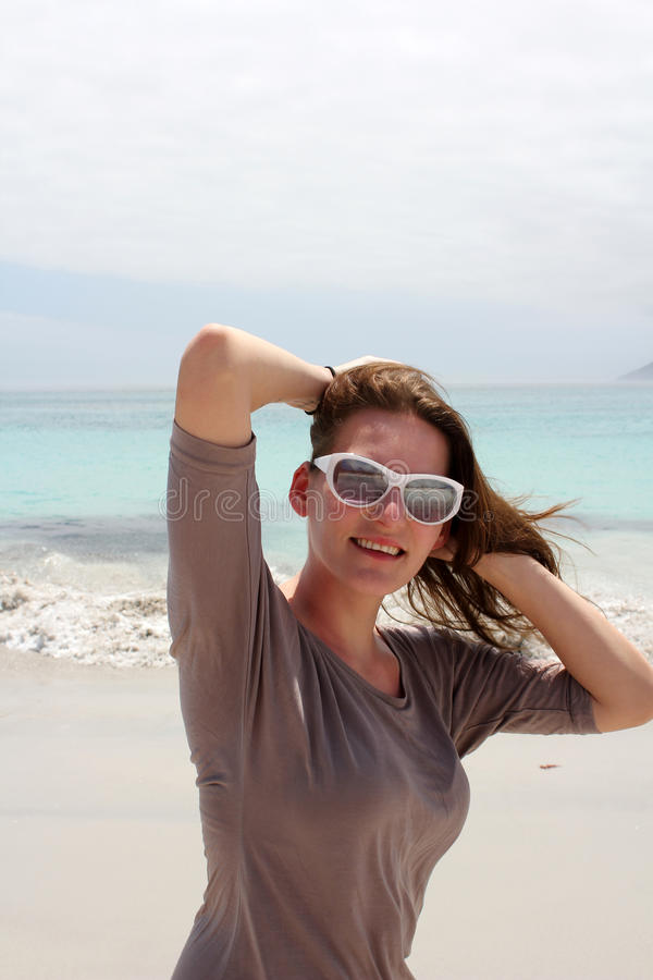 Woman at Beach of Kommetjie royalty free stock photo