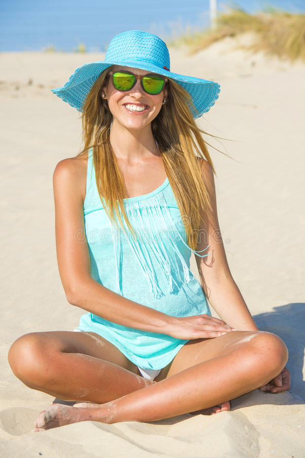 woman on the beach with pamela and blue shirt stock image