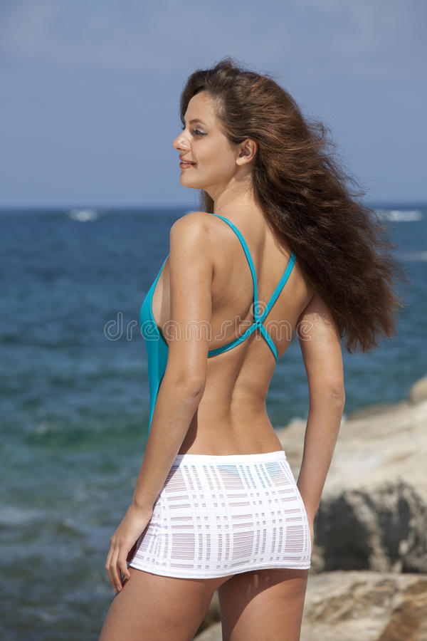 Woman In Beach Skirt And Swimsuit Stock Image
