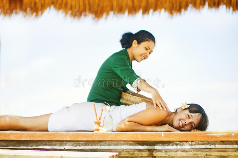 Woman at beach spa stock images