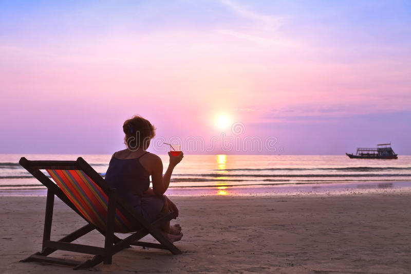 Woman on the beach at sunset royalty free stock photo