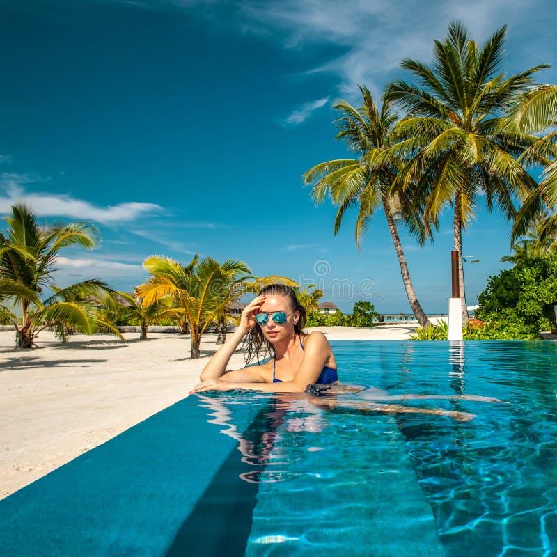 Woman at beach pool in Maldives royalty free stock photo