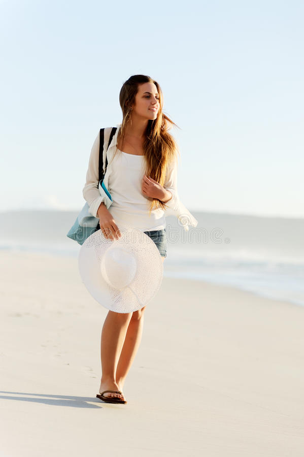 Woman on a beach vacation royalty free stock photo