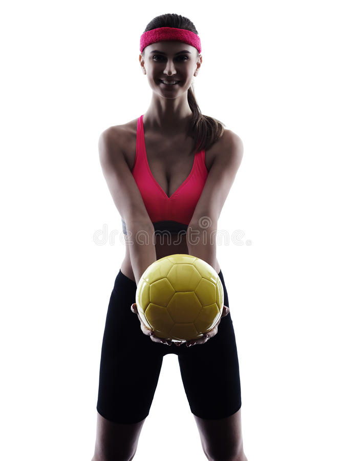 Woman beach volley ball player silhouette. One woman beach volley ball player silhouette in studio silhouette isolated on white background stock photography