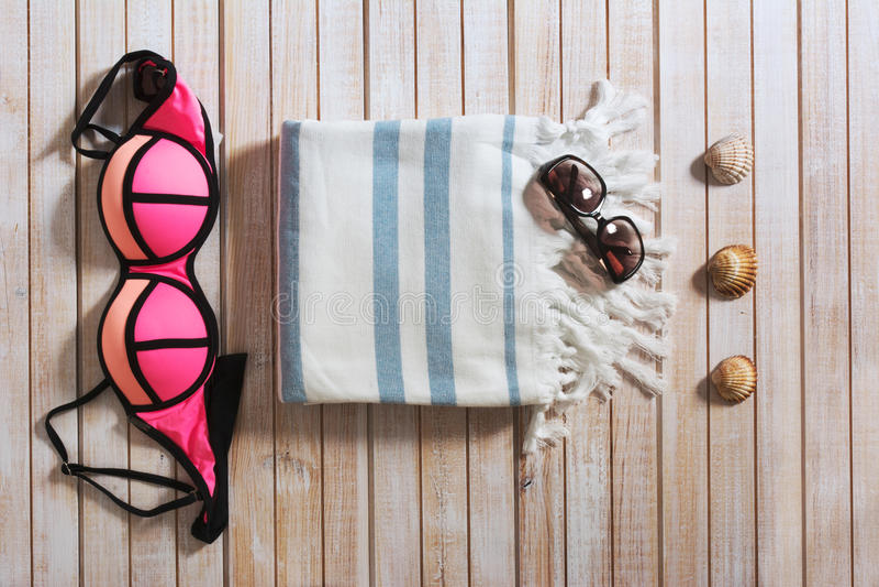 Woman beachwear set, overhead, on wooden background. stock photography
