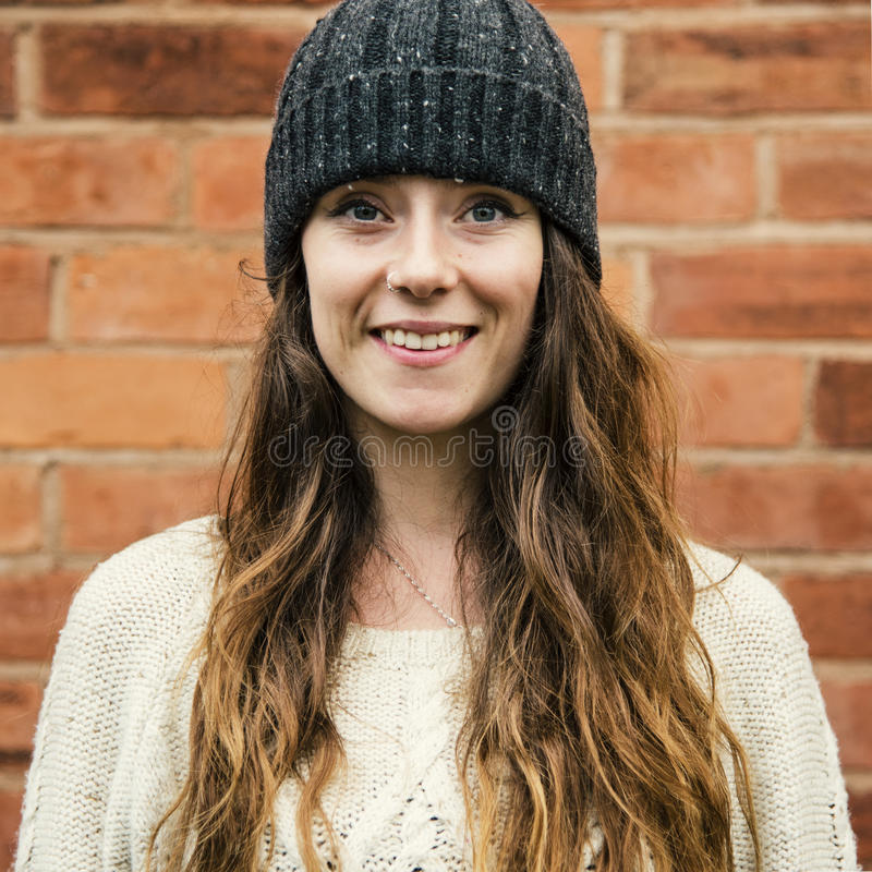 Woman Beanie Hat Hipster Style Brick Wall Smiling Concept. Woman Beanie Hat Hipster Style Brick Wall Smiling stock photos