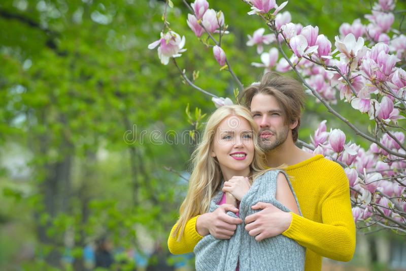Woman with bearded man at magnolia tree royalty free stock images