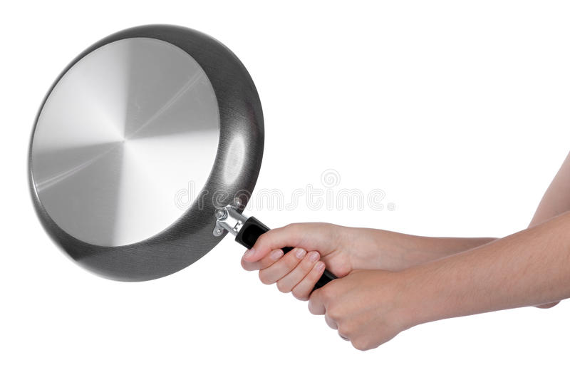 Woman beating with a frying pan stock photo