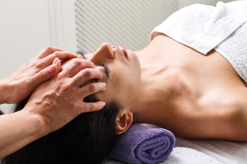 Woman beautician doctor make head massage in spa wellness center royalty free stock photos