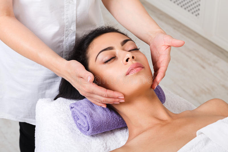 Woman beautician doctor make neck massage in spa wellness center. Neck massage in spa. Female beautician work in wellness center. Professional massagist make royalty free stock image