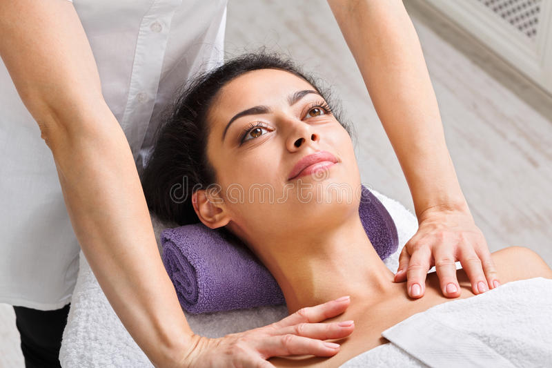 Woman beautician doctor make neck massage in spa wellness center. Neck massage in spa. Female beautician work in wellness center. Professional massagist make stock photography