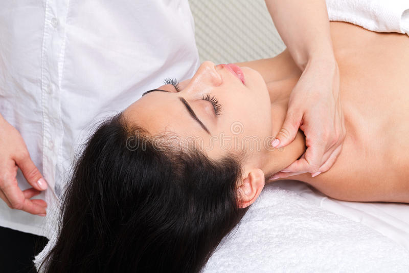 Woman beautician doctor make neck massage in spa wellness center. Neck massage in spa. Female beautician work in wellness center. Professional massagist make stock image