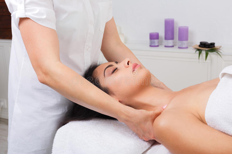 Woman beautician doctor make neck massage in spa wellness center. Unrecognizable female beautician doctor with patient in spa wellness center. Professional royalty free stock photos