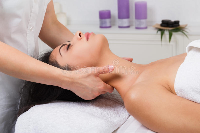 Woman beautician doctor make neck massage in spa wellness center. Unrecognizable female beautician doctor with patient in spa wellness center. Professional royalty free stock image