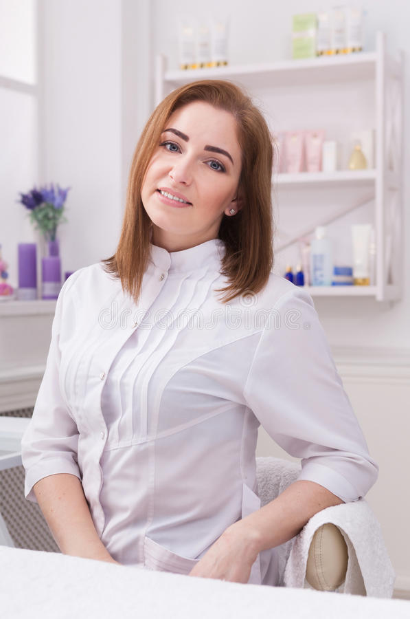 Woman beautician doctor at work in spa center stock photo