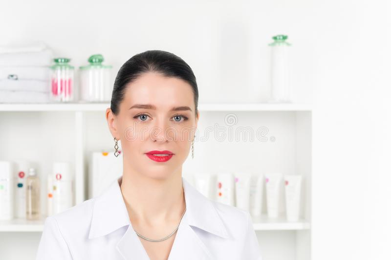 Woman beautician doctor at work in spa center. Portrait of a young female professional cosmetologist. Female employee in royalty free stock images