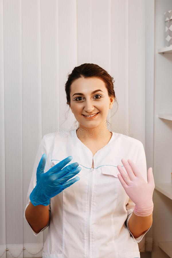 Woman beautician doctor at work in spa center. Portrait of a young female professional cosmetologist royalty free stock photos
