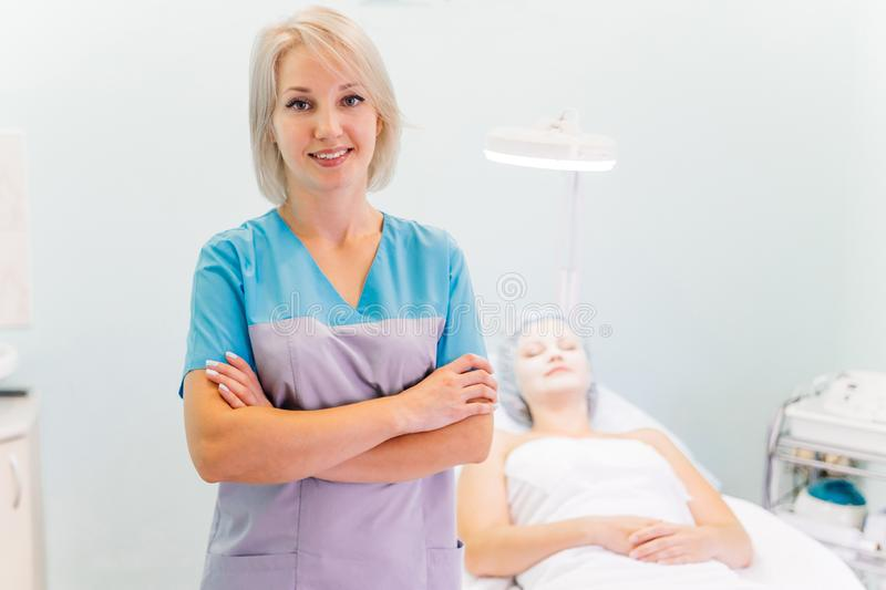 Woman beautician doctor at work in spa center stock image