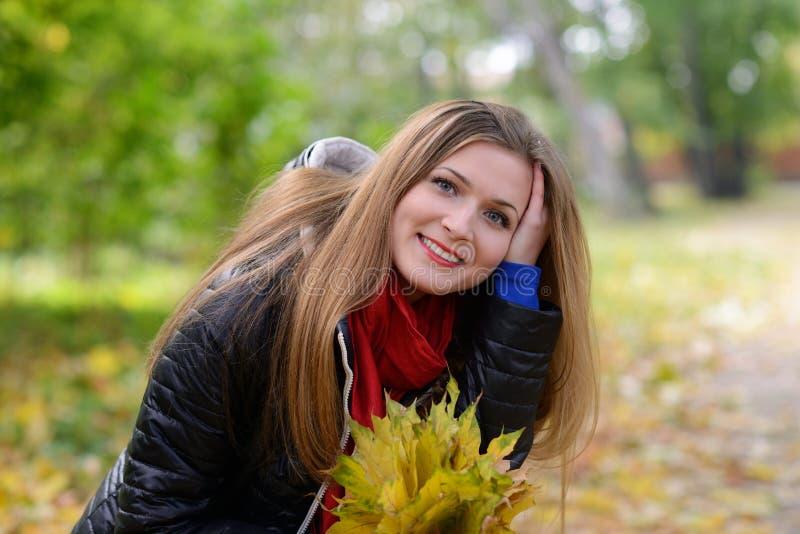 Woman in beautiful autumn park stock photo